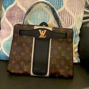 Louis Vuitton cross body bag.